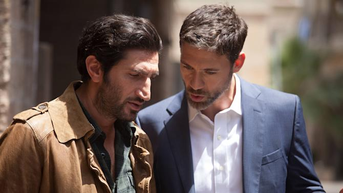 """This photo released by FX shows Fares Fares, left, as Fauzi, and Adam Rayner as Barry, in a scene from the TV series, """"Tyrant,"""" airing Tuesday, July 22, 2014, 10:00 p.m. ET/PT. Production of FX's series """"Tyrant"""" recently relocated from Tel Aviv to Istanbul, showrunner Howard Gordon told a TV Critics' panel Monday, July 21, 2014. (AP Photo/FX, Vered Adir)"""
