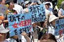Supporters of Korean comfort women, forcibly drafted into Japanese military brothels during World War II, hold a rally in front of the city hall in Osaka, western Japan on May 24, 2013