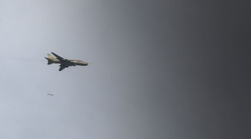 A Syrian air force Sukhoi-22 fighter jet drops a 500lb freefall bomb over the town of Maraat al-Numan on November 17, 2012. Syrian rebels shot down a fighter jet on Wednesday in the embattled northwest of the country near the border with Turkey, said an AFP correspondent on the frontier