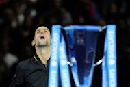 Novak Djokovic produced one of his greatest performances to defeat Roger Federer 7-6 (8/6), 7-5 in the final of the ATP Tour Finals in London. Djokovic has been playing with a heavy heart over the last week at London's O2 Arena as his father Srdjan battles to recover from a blood disorder that struck suddenly a few weeks ago