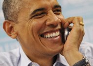 US President Barack Obama smiles as he calls campaign workers during an unannounced stop at a campaign office October 1, in Henderson, Nevada. Obama took time out from debate preparation to stop by the local campaign office where he dropped off pizza for the workers