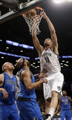 Mavericks hold on to beat Nets 98-90