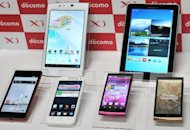 Leading Japanese mobile phone carrier NTT DoCoMo unveils new smartphones in August 2012. Japan&#39;s biggest mobile phone carrier NTT DoCoMo on Friday cut its full-year profit forecast and said quarterly net profit was down 13 percent owing to rising infrastructure costs
