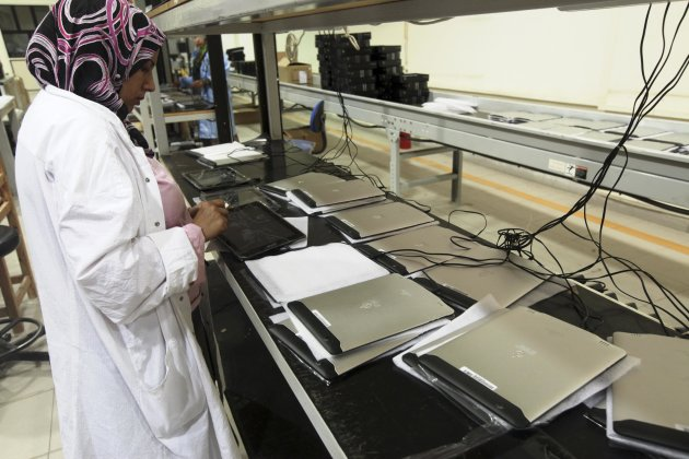 "A worker checks Egypt's first tablet computer ""Inar"" at a factory in Benha"