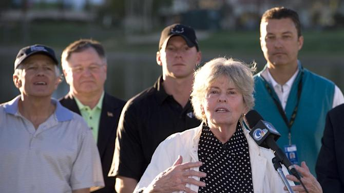 IMAGE DISTRIBUTED FOR HUMANA- Linda Hope, daughter of Bob Hope, speaks at the Humana Challenge Military Appreciation Day Ceremony as (from left) General Wesley Clark, President of Humana Government Business Tim McClain, US military veteran Matt Anderson, and Humana Challenge CEO Bob Marra observe on Saturday,January 19, 2013 at PGA West in La Quinta, Calif. The ceremony,which honored members of the Armed forces and their families, also featured a military flyover and a special donation of a 100% mortgage-free home to a local wounded warrior, courtesy of the Military Warriors Support Foundation. The Humana Challenge is being played Jan 14-20 in La Quinta. (Rodrigo Pena / AP Images for Humana)