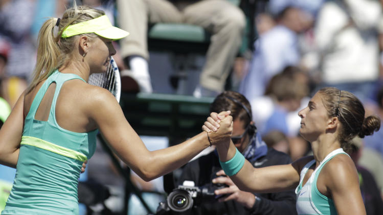 Maria Sharapova, of Russia, clasps hands with Sara Errani, of Italy, after Sharapova defeated Errani 7-5, 7-5 during the quarterfinals at the Sony Open tennis tournament in Key Biscayne, Fla., Wednesday, March 27, 2013. (AP Photo/Luis M. Alvarez)