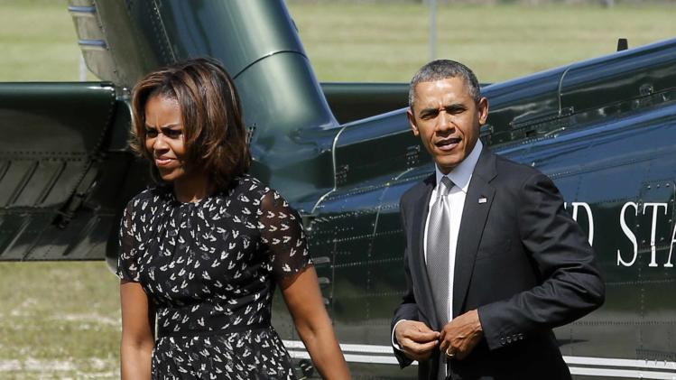 President Barack Obama and first lady Michelle Obama arrive at Coral Reef High School in Miami
