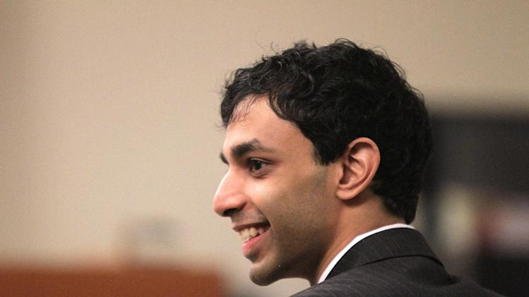 Dharun Ravi shares a laugh with his attorneys during a break in his trial at the Middlesex County Courthouse in New Brunswick, N.J. on Wednesday, March 7, 2012.   Ravi,a former Rutgers University student, is accused of using a webcam to spy on his roommate, Tyler Clementi,  intimate encounter with another man.  Days later  Clementi committed suicide.  Ravi, 19, faces 15 criminal charges, including invasion of privacy and bias intimidation, a hate crime punishable by up to 10 years in state prison. (AP Photo/The Star-Ledger, John O'Boyle, Pool)