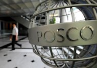 A South Korean man walks in the lobby of the Posco headquarters in Seoul. Posco plans to nearly double its Indonesia investments to $11 billion over five years, the country's chief economics minister said