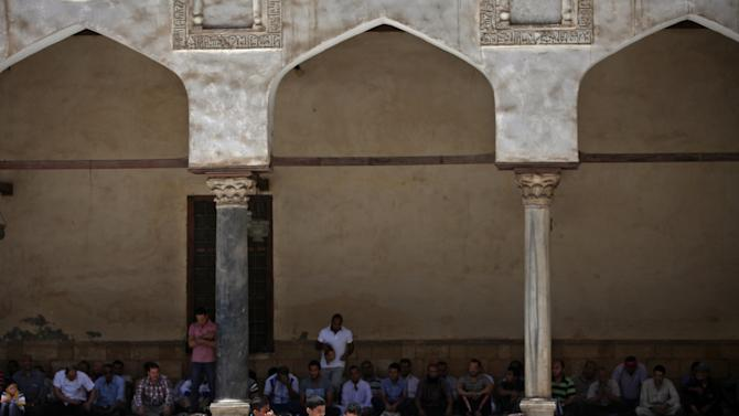 Young boys attend the Friday noon prayer in Al-Azhar mosque in Cairo, Egypt, Friday, May 10, 2013. (AP Photo/Khalil Hamra)