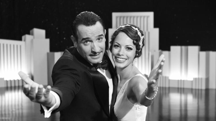"In this film publicity image released by The Weinstein Company, Jean Dujardin portrays George Valentin, left, and Berenice Bejo portrays Peppy Miller in a scene from ""The Artist.""  (AP Photo/The Weinstein Company)"