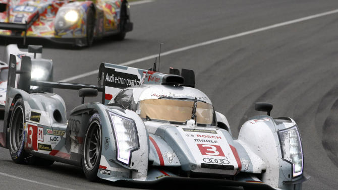 The Audi R18 E-Tron No2 driven by Tom Kristenssen of Denmark turns a corner during the 90th 24-hour Le Mans endurance race, in Le Mans, western France, Sunday, June 23, 2013. (AP Photo/Michel Spingler)