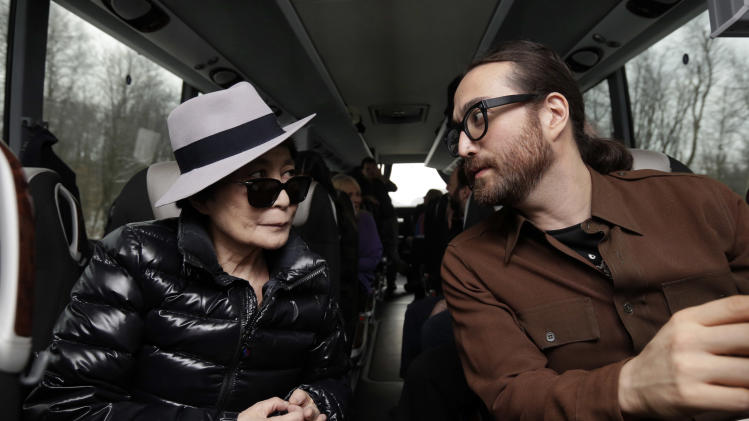 Yoko Ono, left, and her son Sean Lennon chat aboard a bus on the way to visit fracking sites in Pennsylvania Thursday, Jan. 17, 2013. They are touring natural-gas drilling sites in northeastern Pennsylvania and visiting with residents who say they've been harmed by the controversial extraction process known as fracking. (AP Photo/Richard Drew)