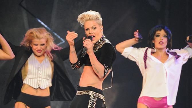 "FILE - This March 22, 2013 file photo shows singer Pink performing during her ""The Truth About Love"" tour at Madison Square Garden in New York. Pink's single, ""Just Give Me a Reason (feat. Nate Ruess),"" was the top song on the iTunes' official music chart for the week ending March 25. (Photo by Evan Agostini/Invision/AP, file)"