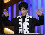 FILE - In this March 2, 2007 file photo, Prince accepts an award during the NAACP Image Awards in Los Angeles. He is scheduled to appear on &quot;Late Night with Jimmy Fallon.&quot; A rep for the late-night talk show confirmed the pop legend will appear on the show Friday, March 1, 2013, and perform two songs. (AP Photo/Chris Carlson, file)