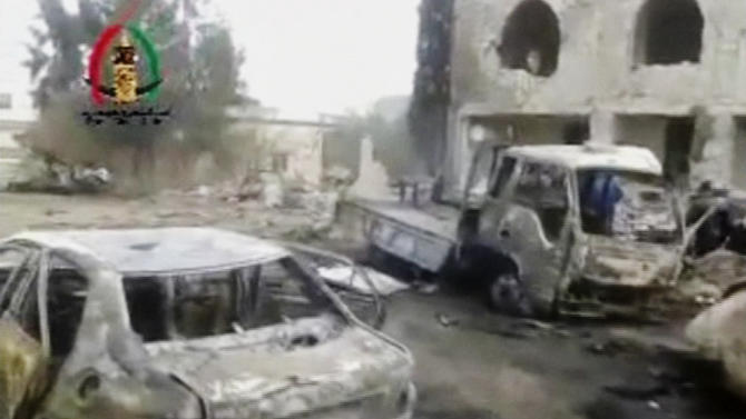 In this image made from video obtained from the Shaam News Network, which has been authenticated based on its contents and other AP reporting, vehicles smolder after an explosion outside a mosque in Yadouda, Syria, Friday, Feb. 14, 2014. A car bomb blew up outside a mosque in a rebel-held village in southern Syria as worshippers were leaving after Friday prayers, killing dozens of people and filling clinics and hospitals with the wounded, anti-government activists said. (AP Photo/Shaam News Network)