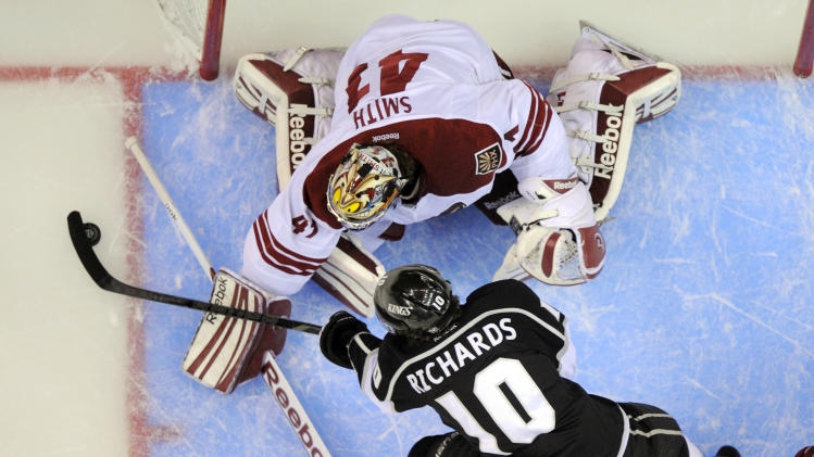 Los Angeles Kings center Mike Richards, below, shoots on Phoenix Coyotes goalie Mike Smith during the first period in Game 4 of the NHL hockey Stanley Cup Western Conference finals, Sunday, May 20, 2012, in Los Angeles. (AP Photo/Mark J. Terrill)