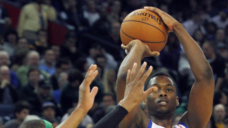 Golden State Warriors' Harrison Barnes (40) shoots as Boston Celtics' Paul Pierce guards during the second half of an NBA basketball game in Oakland, Calif., Saturday, Dec. 29, 2012. (AP Photo/George Nikitin)