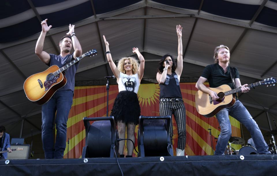 Little Big Town performs at the New Orleans Jazz and Heritage Festival in New Orleans, Saturday, May 4, 2013. (AP Photo/Gerald Herbert)