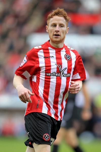 Stephen Quinn moves to HUll after seven-year stay at Bramall Lane