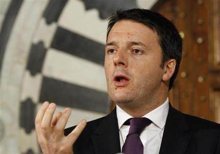 Italian Prime Minister Matteo Renzi speaks during a news conference at the Government Palace in Tunis