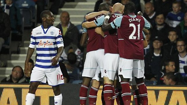 West Ham players mob Matt Jarvis following his opening goal against QPR
