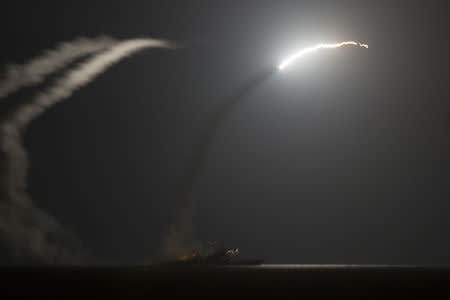 The guided-missile cruiser USS Philippine Sea launches a Tomahawk cruise missile while conducting strike missions against ISIL targets from the Arabian Gulf