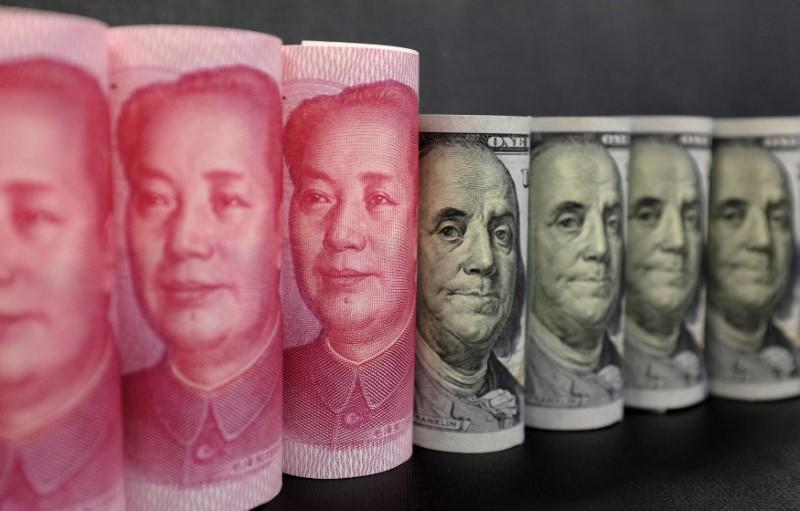 China Nov forex reserves fall more than expected to lowest in nearly six years