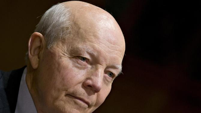 John Koskinen, President Barack Obama's choice to head the Internal Revenue Service (IRS) testifies on Capitol Hill in Washington, Tuesday, Dec. 10, 2013, before the Senate Finance Committee hearing on his nomination. Koskinen, 74, is a retired corporate and government official with experience managing numerous organizations in crisis. (AP Photo/J. Scott Applewhite)