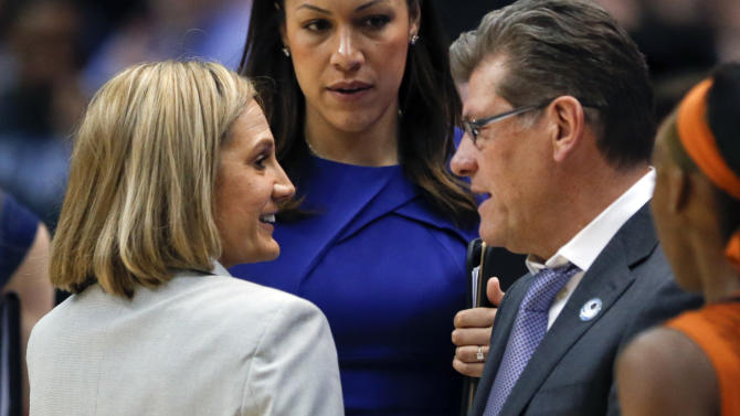 Texas head coach Karen Aston, left, and Connecticut head coach Geno Auriemma talk after UConn's 105-54 win in the second half of a women's college basketball regional semifinal game in the NCAA Tournament on Saturday, March 28, 2015, in Albany, N.Y. (AP Photo/Mike Groll)