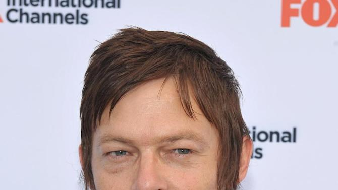 """COMMERCIAL IMAGE -  Norman Reedus attends  AMC's """"The Walking Dead"""" Fox Breakfast on Friday July 13, 2012, in San Diego. (Photo by John Shearer/Invision for AMC/AP Images)"""