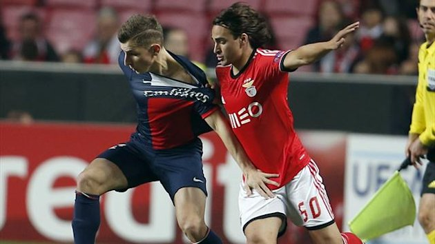 Paris St Germain's Lucas Digne (L) is challenged by Benfica's Lazar Markovic during their Champions League match
