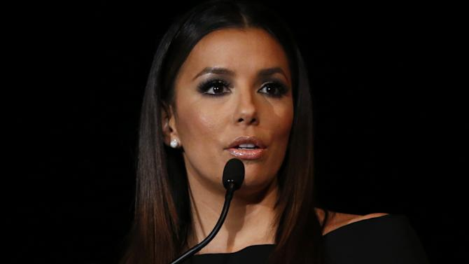 Eva Longoria delivers an impassioned keynote address at the Fourth Annual Latino Entrepreneur of the Year Awards Gala presented by Verizon Wireless in Long Beach, Calif. on Nov. 7. Eva joined Verizon Wireless in celebrating the accomplishments of entrepreneur Monica Gonzales, of Aldabella Scarpa, who will receive a $15,000 grant and 4G LTE Motorola smartphones to help spur technological advancement for her business. (Photo by Todd Williamson/Invision for Verizon Wireless/AP Images)