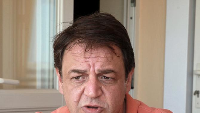 "Dimitris Danikoglou, 48, speaks during an interview at his apartment in Athens, Saturday, July 4, 2015. Meet the Danikoglous, a typically intense, articulate Greek family divided over how best to cope with Greece's careening financial crisis, which may lead to a break with the eurozone and the European Union if voters Sunday say ""no"" to a proposed bailout plan that would impose still more years of austerity on an already crushed Greek economy. They are united in their belief that only as a strong family can they weather the coming storm. And they share a sense that Greece, so rich with history and culture, has fallen tragically short of its potential. (AP Photo/Spyros Tsakiris)"