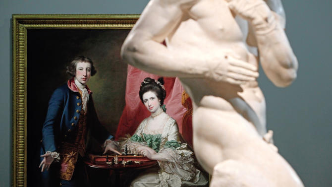"Francis Cotes' painting named ""Portrait of William Welby and his wife Penelope Playing Chess"" (1769) and Antonio Canova's sculpture named ""The Pugilists Creugas and Damoxenos"" (1797-1803) are displayed as part of the exhibition ""Louvre Abu Dhabi. Birth of a Museum"", at the Louvre museum, in Paris, Monday, April 28, 2014. The Louvre Abu Dhabi, the Persian Gulf's first ever world museum, will open its doors in December 2015 in the arid Arab federation. Several thousand kilometers away on Tuesday the Louvre in Paris previewed the art that the Abu Dhabi project has acquired since 2009 for the first time to a European audience. (AP Photo/Thibault Camus)"