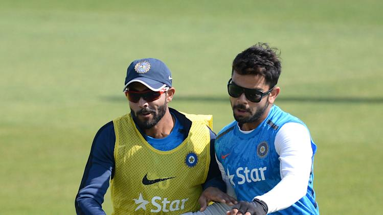 India's Ravindra Jadeja and Virat Kohli run during the nets session at the Ageas Bowl, Southampton, Friday, July 25, 2014. India will face England in the third cricket test match in Southampton on Sunday. (AP Photo/PA, Andrew Matthews) UNITED KINGDOM OUT