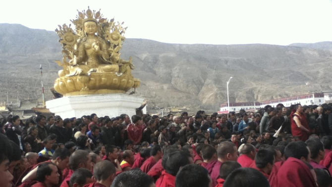 In this Wednesday, March 14, 2012 photo released on Thursday, March 15, 2012 by Freetibet.org, Tibetan monks gather in protest after the latest self-immolation attempt in Tongren, a monastery town in Qinghai province, western China. A Tibetan monk set himself on fire in western China and survived after security forces put out the blaze on Wednesday, an overseas activist group and a Chinese state news agency reported, the latest self-immolation by Tibetans over the suppression of their religion and culture. (AP Photo/Freetibet.org)