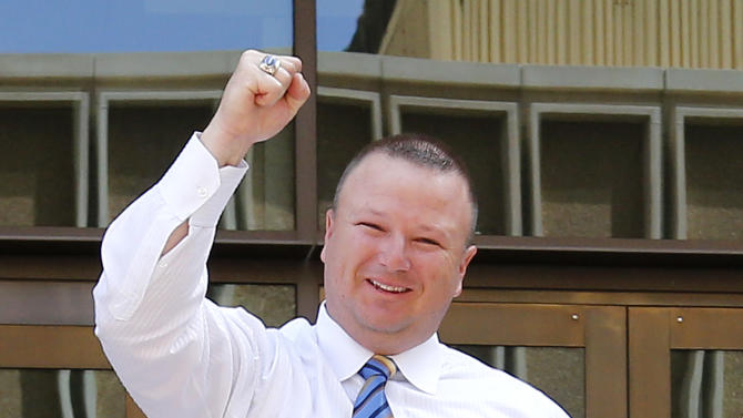 David Hall, a friend of Travis Alexander, pumps his fist outside Superior Court in Phoenix, Wednesday, May 8, 2013 to a guilty verdict in the trial of Jodi Arias. Arias was a waitress and aspiring photographer charged with killing her boyfriend, Travis Alexander, in Arizona in 2008. The four month trial included graphic details of their sexual escapades and photos of Alexander just after his death. (AP Photo/Matt York)