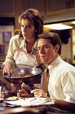 "Malcom's parents Lois (Jane Kaczmarek, L) and Hal (Bryan Cranston, R) enjoy a ""traditional"" family breakfast in the ""Red Dress"" episode of Fox's Malcolm In The Middle"
