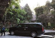 The presidential SUV is seen outside the house of actor George Clooney in Studio City, California. President Barack Obama jetted into Hollywood for a Clooney-hosted fundraiser Thursday tipped to make a record-breaking $15 million, and add a touch of stardust to his re-election campaign