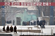 "<p>North Korean workers pass beneath a banner saying ""The Great General Kim Jong-Un"" at the North Korean town of Sinuiju as seen from the Chinese city of Dandong on February 13, 2013. The UN Security Council on Thursday imposed new sanctions against North Korea amid escalating tensions as the North threatened a pre-emptive nuclear strike against the United States.</p>"