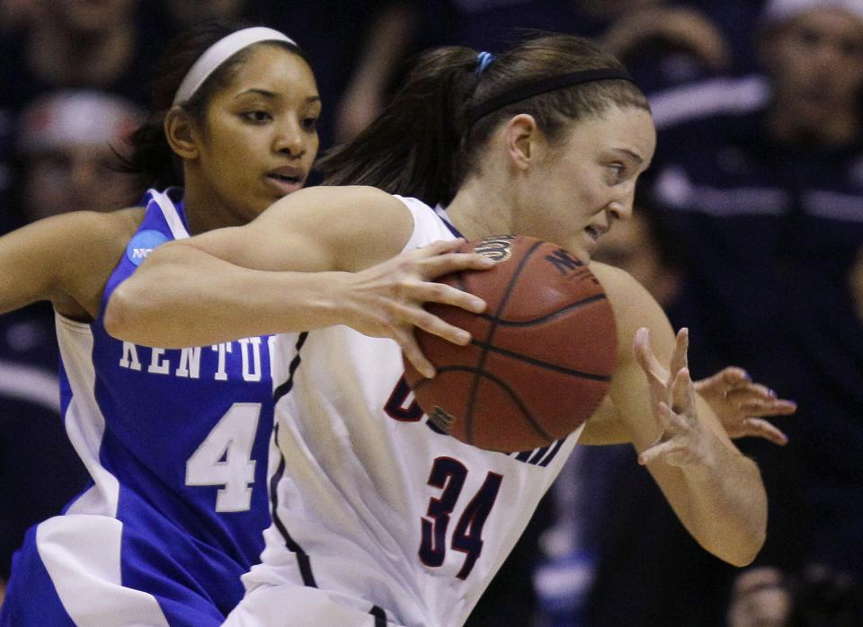 Connecticut guard Kelly Faris (34) drives to the basket past Kentucky guard Keyla Snowden (4) during the second half of an NCAA women's college basketball tournament regional final in Kingston, R.I., Tuesday, March 27, 2012. Connecticut won 80-65.(AP Photo/Stephan Savoia)