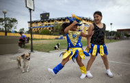 "Girls, members of the murga ""Los amantes de La Boca"", rehearse before participating in carnival celebrations in Buenos Aires, Argentina, Saturday, Feb. 2, 2013. Argentina's carnival celebrations may not be as well-known as the ones in neighboring Uruguay and Brazil, but residents of the nation's capital are equally passionate about their ""murgas,"" or traditional musical troupes. The murga ""Los amantes de La Boca,"" or ""The Lovers of The Boca"" is among the largest, with about 400 members. It's a reference to the hometown Boca Juniors, among the most popular soccer teams in Argentina and the world. In background, Boca Juniors soccer team's stadium. (AP Photo/Natacha Pisarenko)"