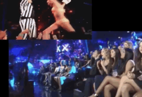 Taylor is caught laughing at Miley's racy performance (Photo: YouTube)