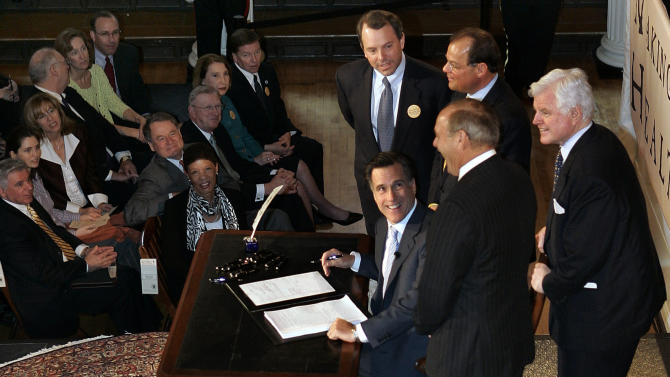 """FILE - In this April 12, 2006, file photo Massachusetts Gov. Mitt Romney, reacts at Faneuil Hall in Boston after signing into law his landmark health care bill, designed to guarantee health insurance to virtually all Massachusetts residents. The law provided a blueprint for President Barack Obama's health care law, which Romney has vowed to dismantle. Ironically the """"Romneycare"""" vs. """"Obamacare"""" debate has given Romney with his most succinct retort, that issues of health care should be left to the states, not the federal government. (AP Photo/Elise Amendola, File)"""