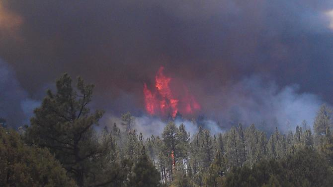 This image provided by the U.S. Forest Service shows a May 29, 2012 photo, of the massive blaze in the Gila National Forest, seen from Neighbors Mountain directly east of Glenwood, N.M. Fire officials said Wednesday the wildfire has burned more than 265 square miles has become the largest fire in New Mexico history. (AP Photo/U.S. Forest Service)