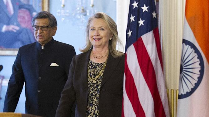 Secretary of State Hillary Rodham Clinton and Indian Foreign Minister S.M. Krishna walk to a joint news conference, Wednesday, June 13, 2012,  at the State Department in Washington.  (AP Photo/Manuel Balce Ceneta)