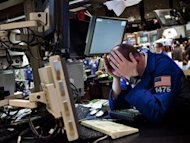 A trader works on the floor of the New York Stock Exchange at the end of the trading day, in New York