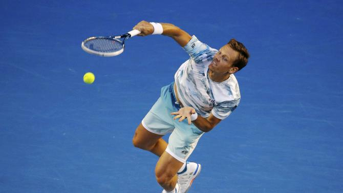 Berdych of Czech Republic serves to Murray of Britain during men's singles semi-final match at the Australian Open 2015 tennis tournament in Melbourne