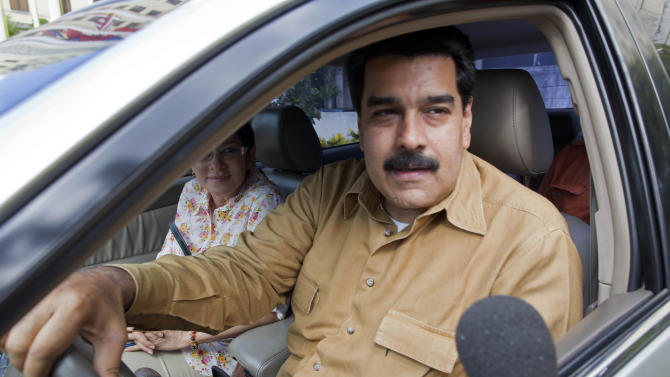 Venezuela's Vice President Nicolas Maduro speaks to a reporter before driving away from the National Hotel where he met with Argentina's President Cristina Fernandez, in Havana, Cuba, Saturday, Jan. 12, 2013. Maduro and Fernandez are in Cuba to visit Venezuela's ailing President Hugo Chavez. The 58-year-old president is fighting a severe respiratory infection a month after he underwent cancer surgery in Havana, his government says. (AP Photo/Ramon Espinosa)